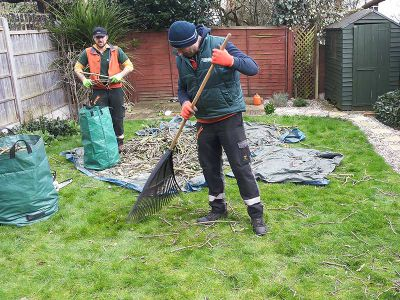 raking the lawn to gather the smallest bits of branches