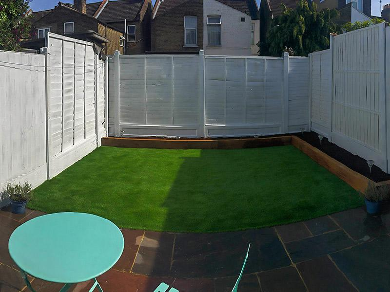 new astro turf, painted fence