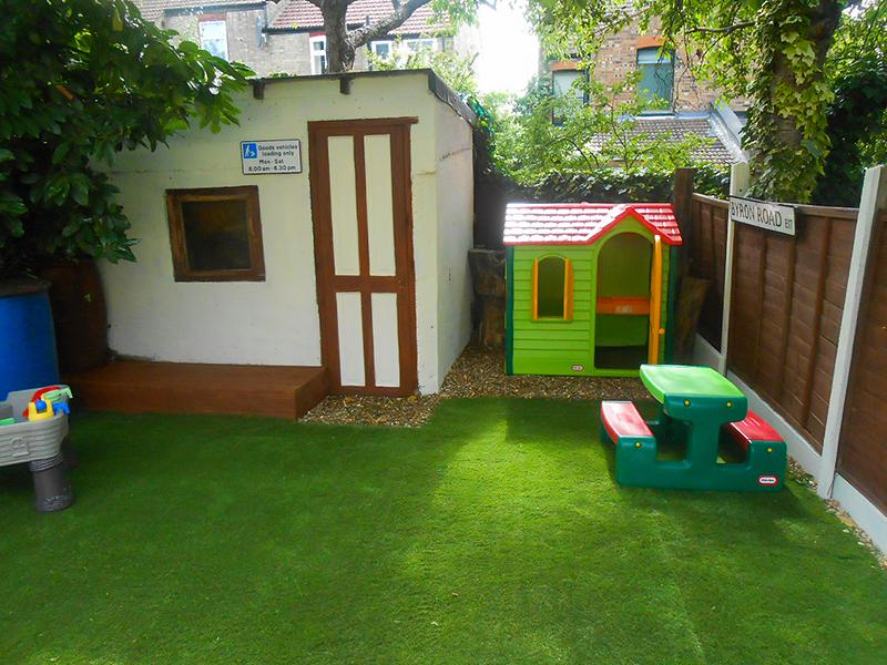 the playground area and painted shed