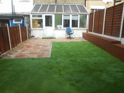 the new artificial lawn and cleaned patio