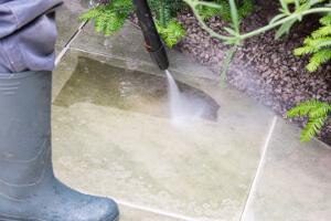 gardener jet washing a patio in Liverpool