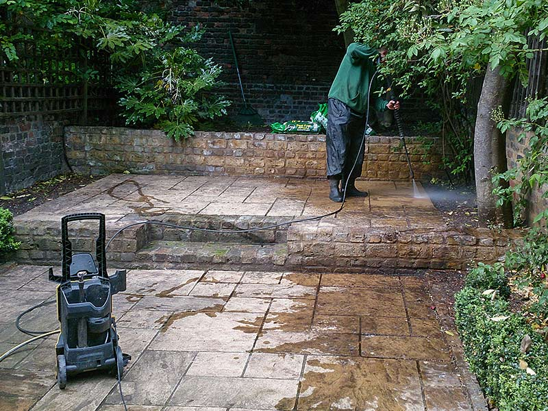 pressure washing a patio in NW6