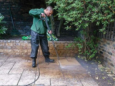 gardener washing a patio