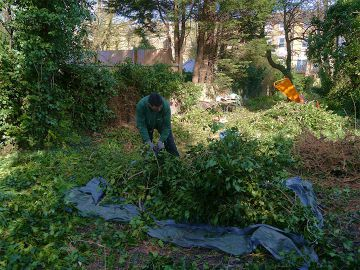 gardeners collecting the green waste