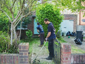 gardeners maintaining a front yard in West Norwood
