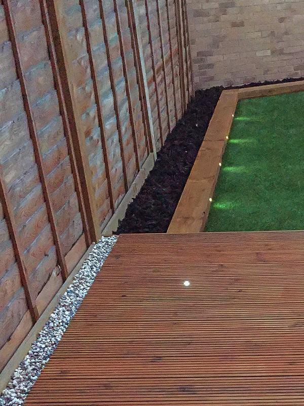 decking installation, built flowerbeds and lights