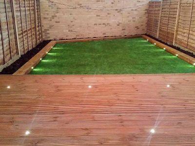 decking installation with garden lighting