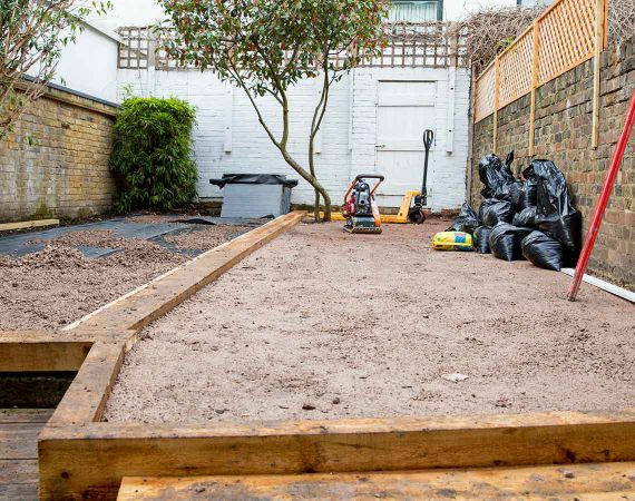 paving and artificial grass installation in progress