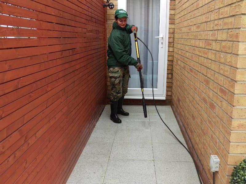 gardener pressure cleaning front tiles