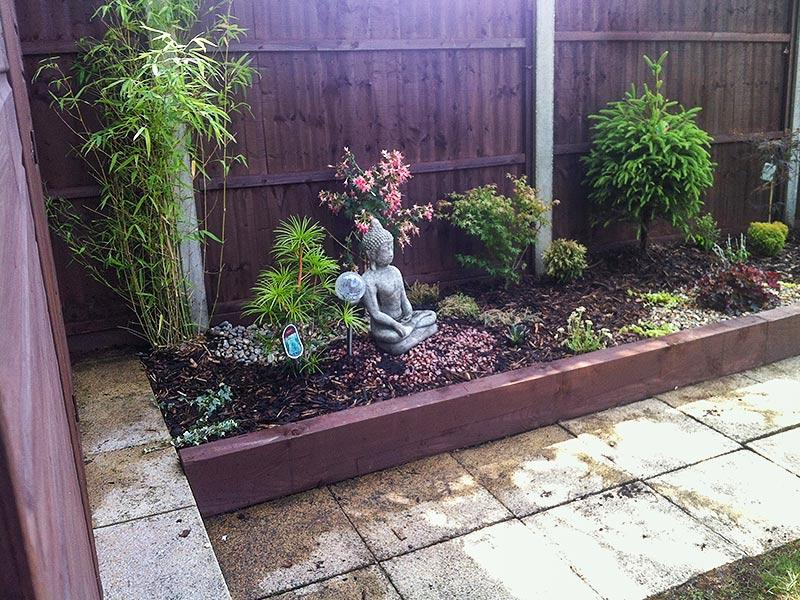 raised flower bed with a statue