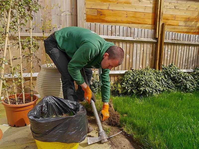 landscaper removing turf