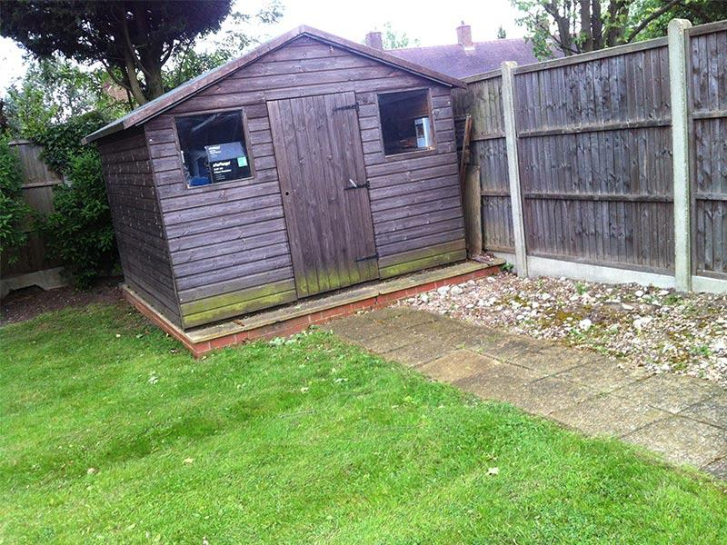the shed and flowerbed area before the job