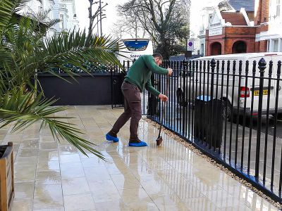 mopping tiles after pressure washing